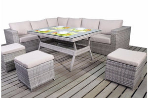 Seating for 9 adults around a grey rattan corner dining sofa set with beige cushions, three footstools and glass top table by Gardenbox