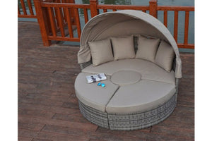 Relax with seating for 8 on this large daybed in Grey Rattan with thick beige cushions by Gardenbox