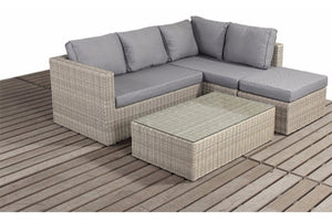 Mixed grey cushions on a natural wicker style rattan weave small corner garden sofa furniture set