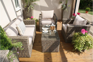 Heavyweight beige cushions and wicker style rattan in the Exeter Square Shaped 2 Seater Sofa set from Gardenbox