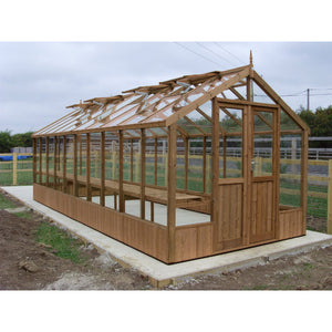 A Swallow Raven 8ft wide by 20ft deep wooden greenhouse finished in natural thermowood