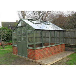 An 8x10 Swallow Raven Wooden Greenhouse finished in Bracken