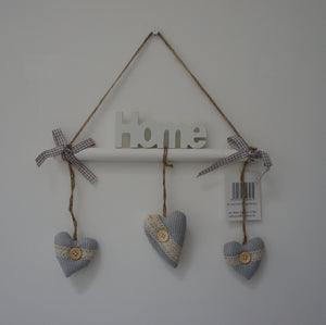 Decorative White Stick Wall Hanger with the words Home or Love with Grey Hanging Love Hearts - Gardenbox
