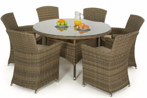 Outdoor dining for 6 people with this wicker style oval set with 6 carver chairs