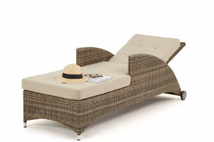Wicker style rattan reclining sun lounger with beige cushions by Gardenbox
