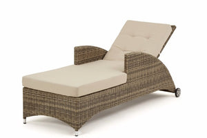 Wicker style rattan reclining sun lounger with beige cushions