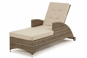 Wicker style Exeter Rattan Weave on the reclining sun loungers with beige cushions and arm rests