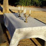 Natural light grey linen tablecloth with a classic ornament for a piknic in the park