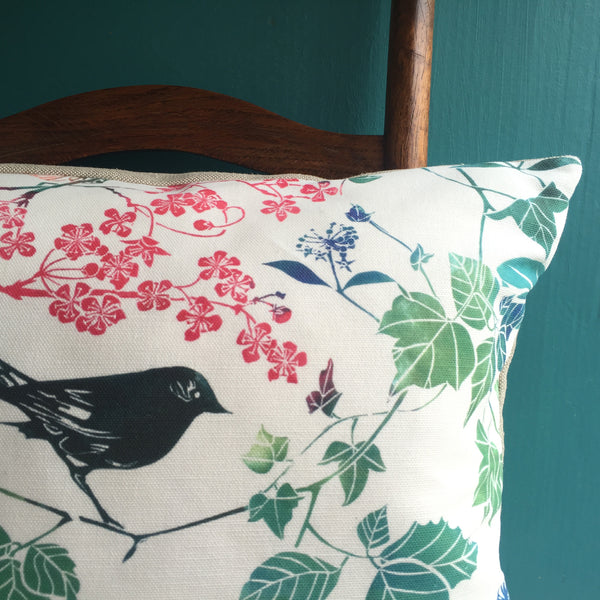 Pure linen cushion with linocut print of bird and Blossom