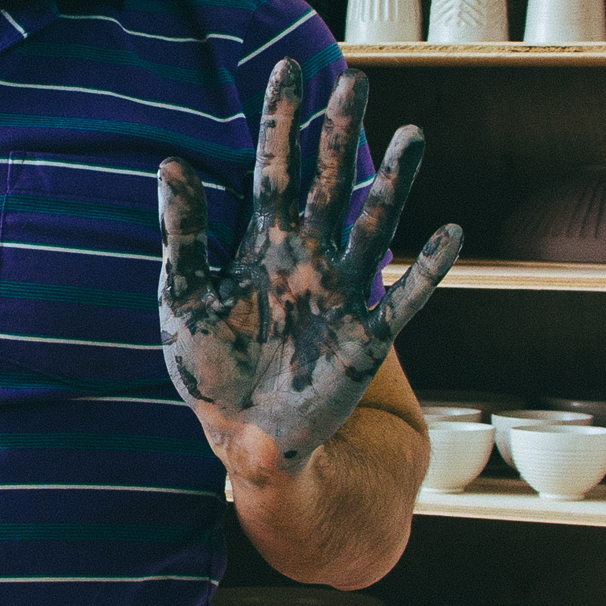 Christian Roy Hand Covered in Clay