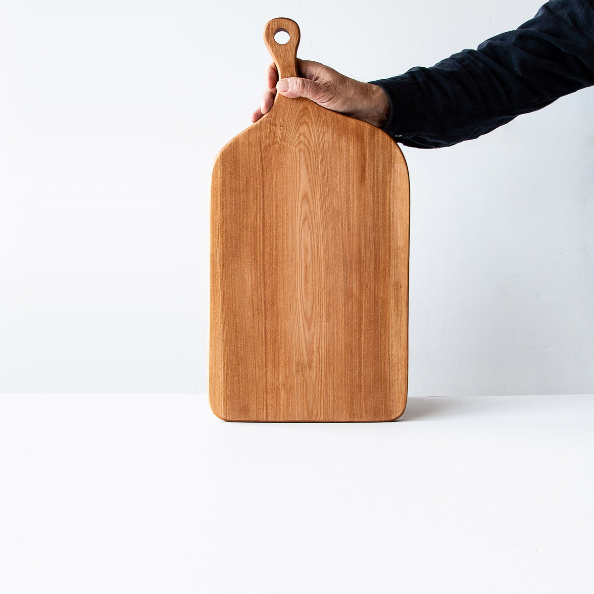 Man Holding a Muskoka N°5 - Large Handmade Serving Board in Birch - Sold by Chic & Basta