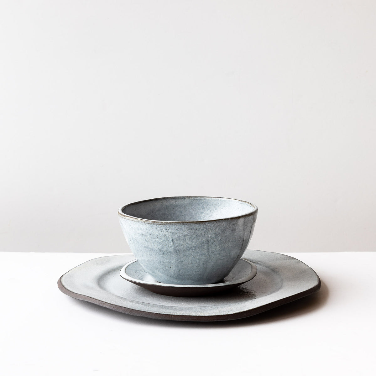 Side View - Handmade 3-Piece Dinnerware Set - In Grey & White Stoneware - Sold by Chic & Basta