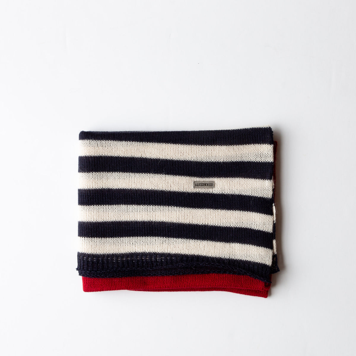 A long thin knit scarf with wide stripes at the ends.