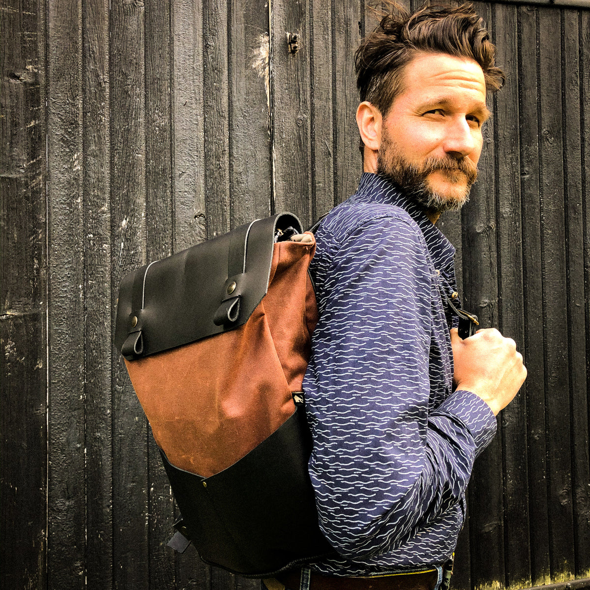 Male Model Wearing an Handmade 15 Inch Laptop Backpack - Leather & Waxed Cotton