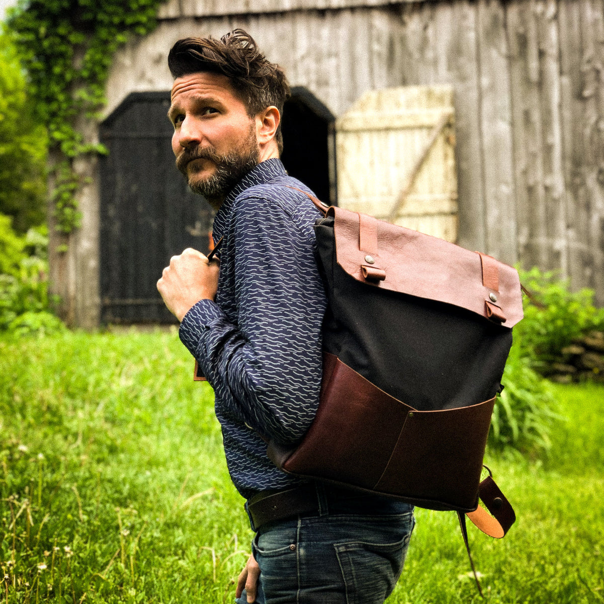 Male Model Wearing a Andes - Handmade 15 Inch Laptop Backpack - Leather & Waxed Cotton