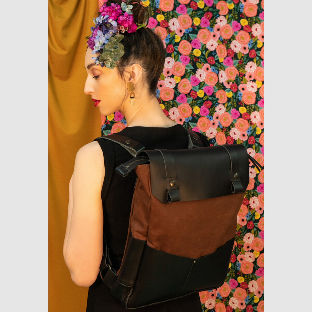 Model Wearing a Black Leather & Brown Waxed Cotton - Handmade 15 Inch Laptop Backpack - Leather & Waxed Cotton - Sold by Chic & Basta