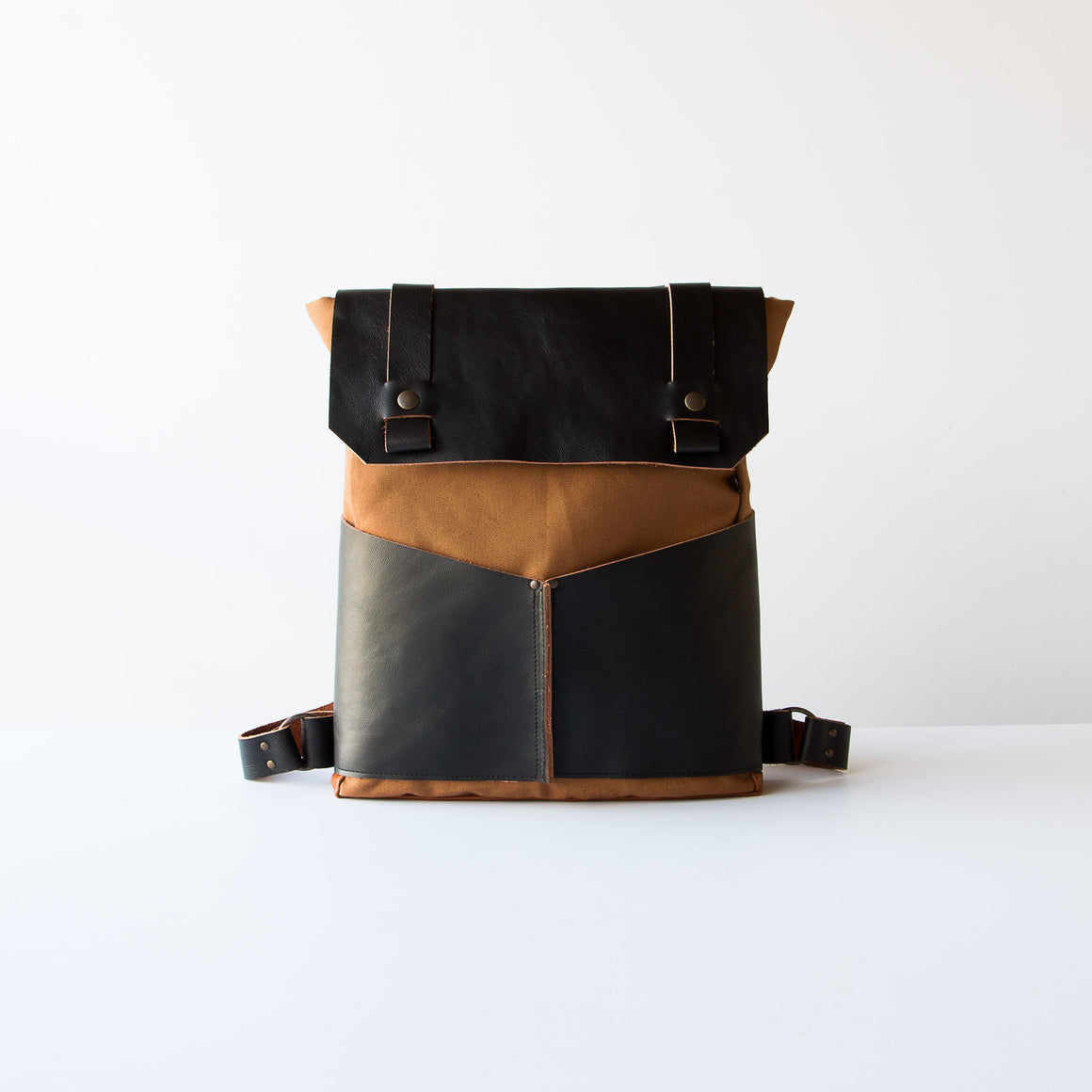 Man Wearing a Leather & Cotton Backpack - Handmade in Montreal, Canada.