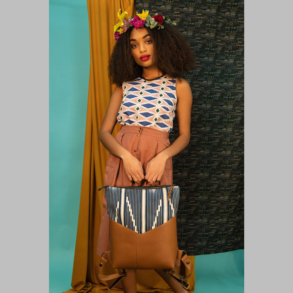 Model Wearing a Handcrafted 13 Inch Laptop Backpack in Leather &  Ivorian Indigo Fabric - Sold by Chic & Basta