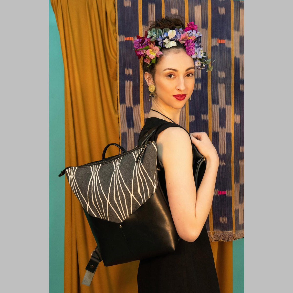 Model Wearing a Handcrafted 13 Inch Laptop Backpack in Leather &  Charcoal Losange Fabric - Sold by Chic & Basta