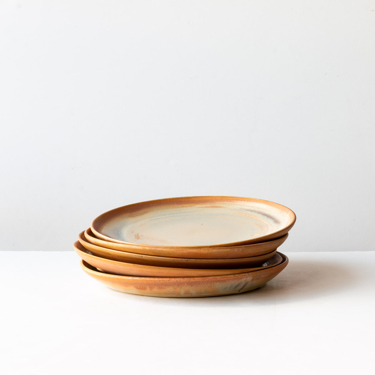 A Pile of Handmade Stoneware Dinner Plates - Barley Corn Colour - Sold by Chic & Basta