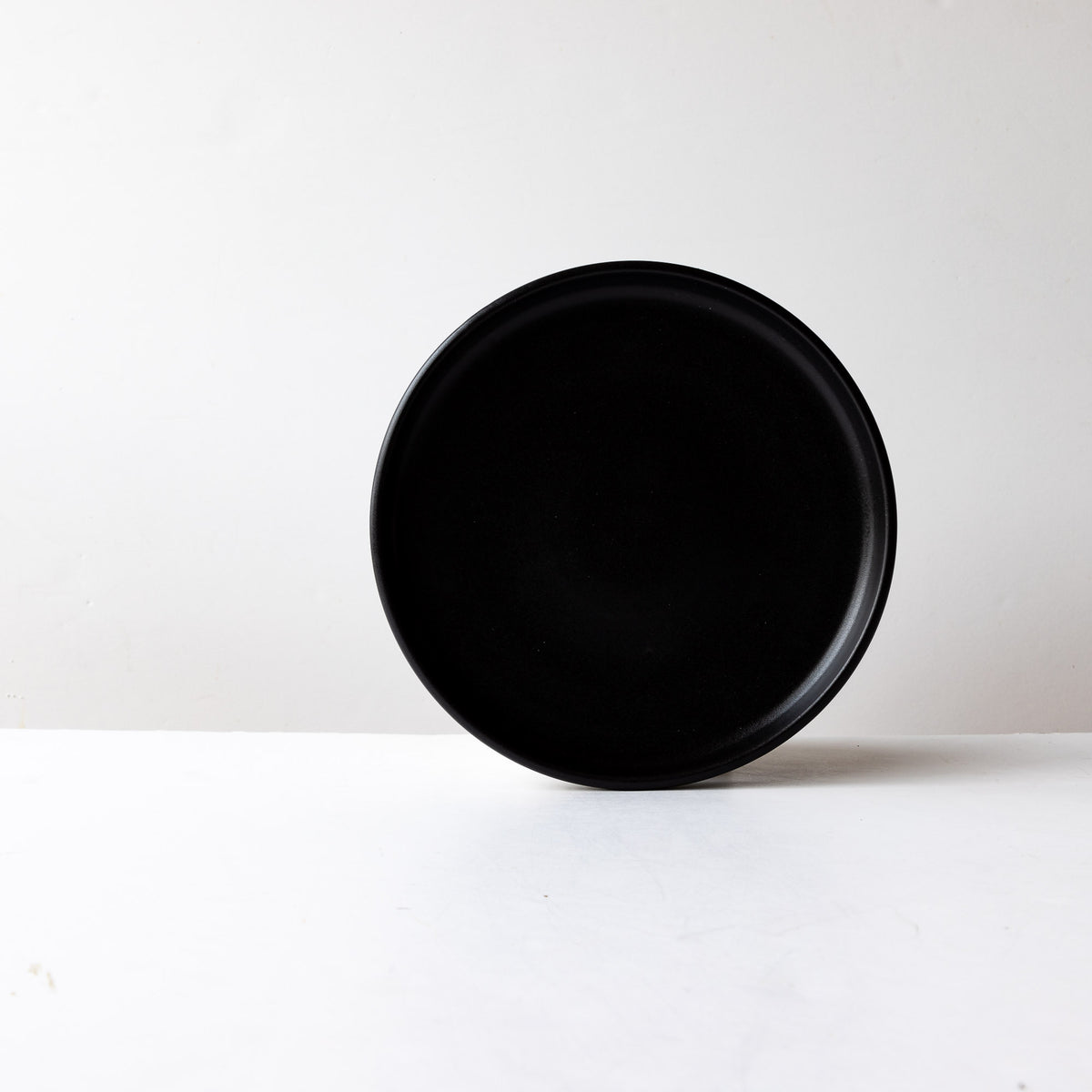 Front View - Black Satin Glaze Hand Thrown Medium Porcelain Plate - Sold by Chic & Basta