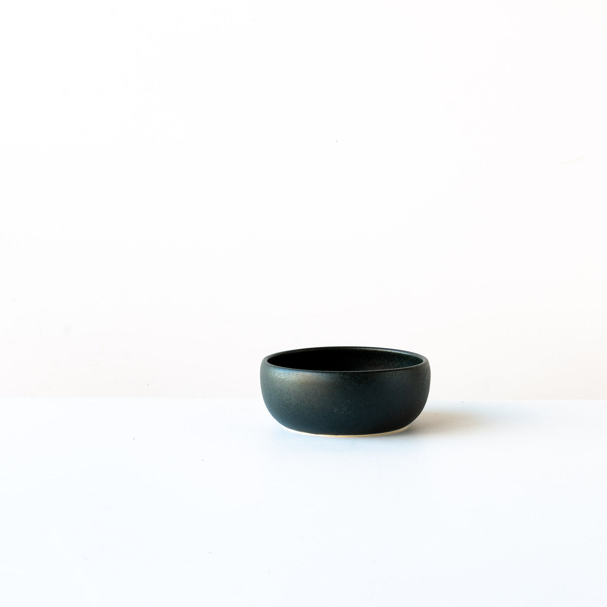 Side View - Black Satin Glazed Porcelain Small Flat Bowl - Sold by Chic & Basta