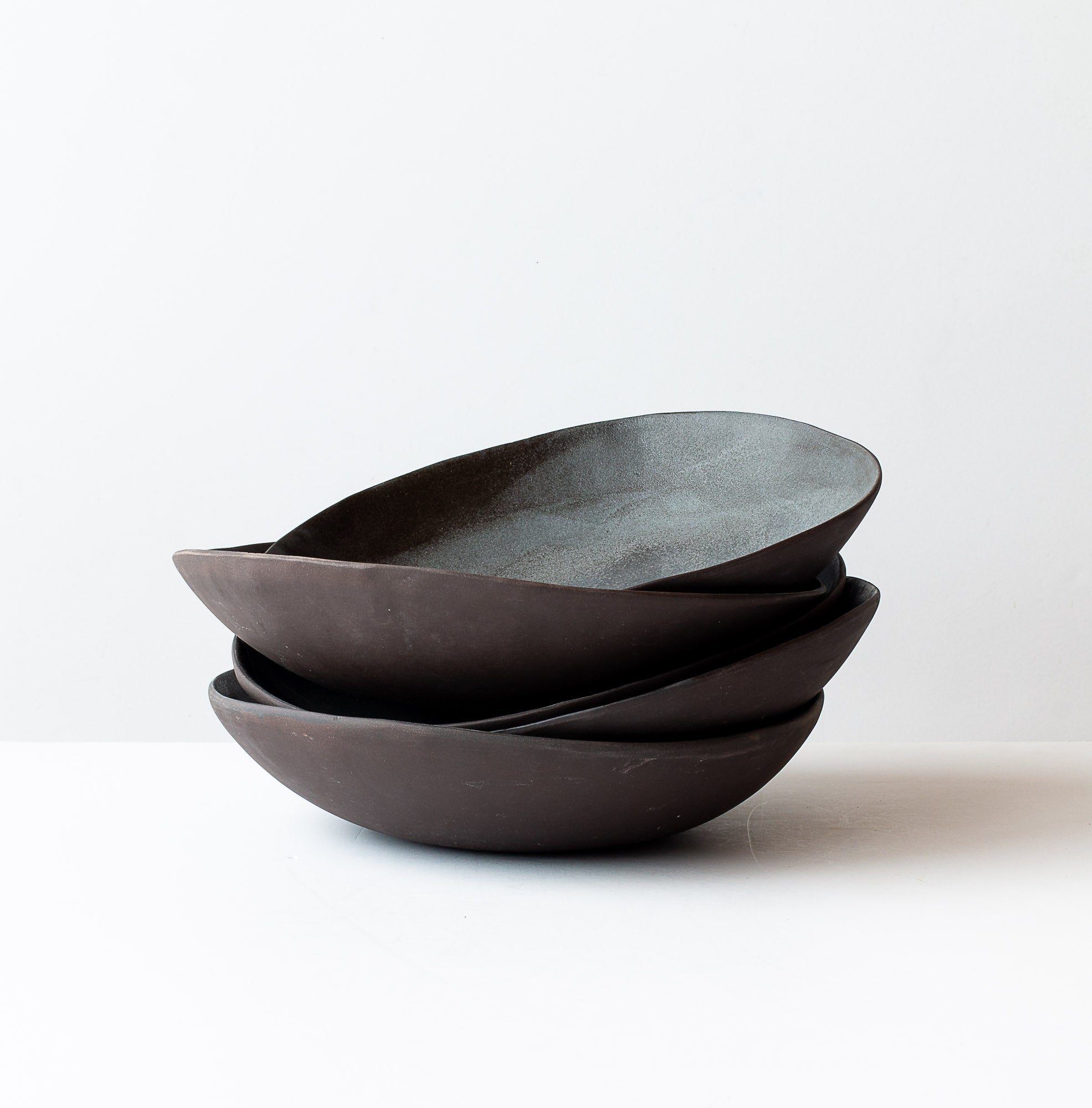 Pile of Five Handmade Wabi-Sabi Black Stoneware Dinner Size Bowls - Sold by Chic & Basta