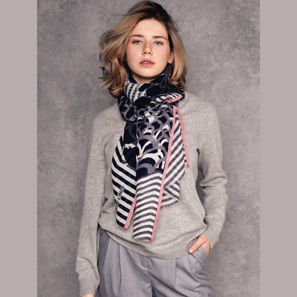 Model Wearing a Céleste - 100% Fine Merino Wool Scarf - Black & Grey - Sold by Chic & Basta