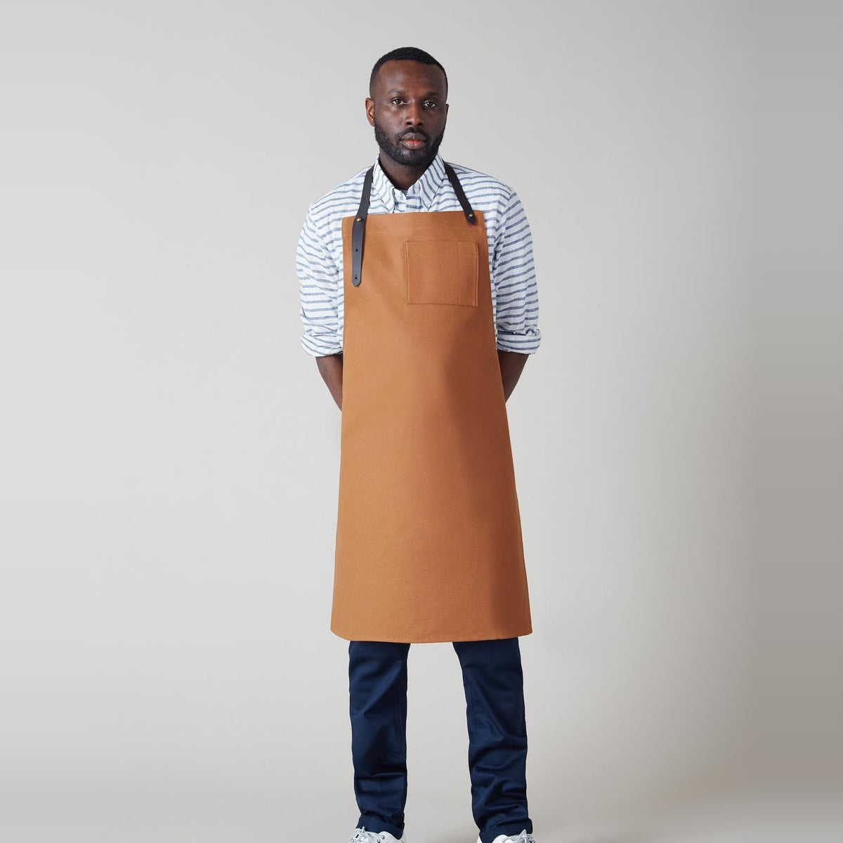 Model Wearing a Handmade Unisex Camel Canvas & Leather Apron - Sold by Chic & Basta