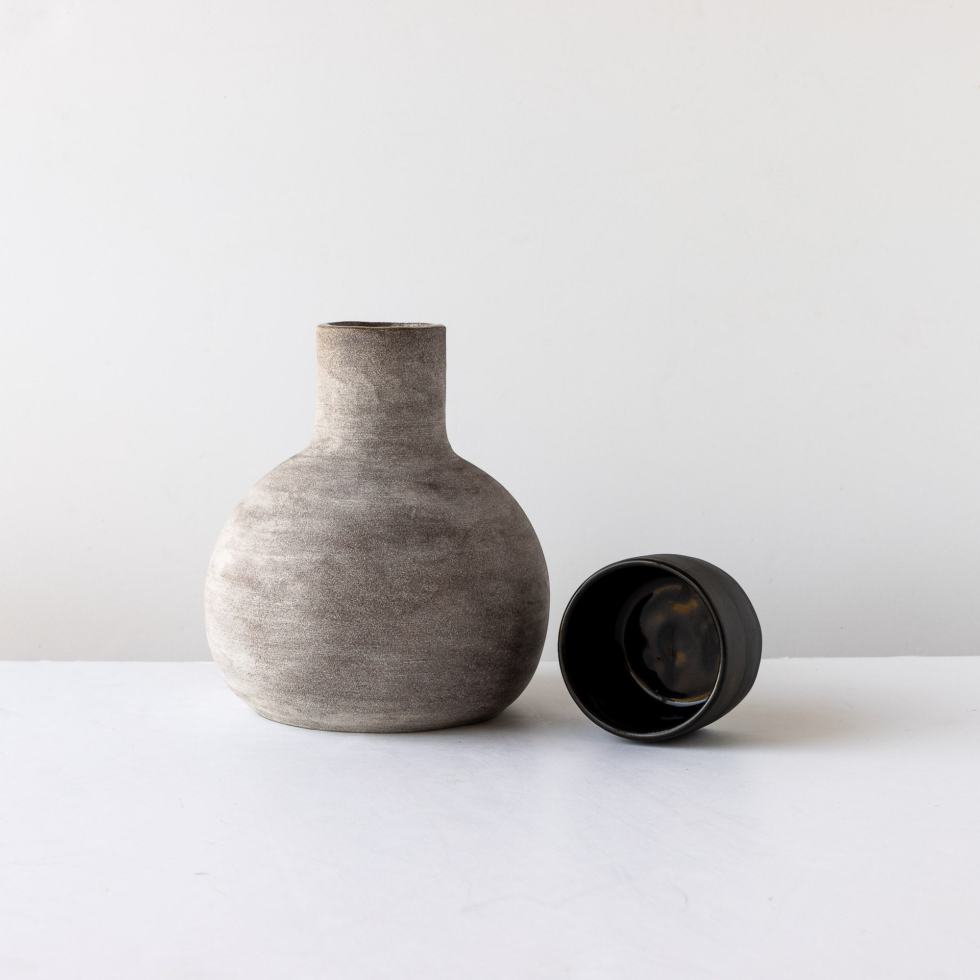 Two Handmade Stoneware Carafe & Tumbler Sets - Sold by Chic & Basta