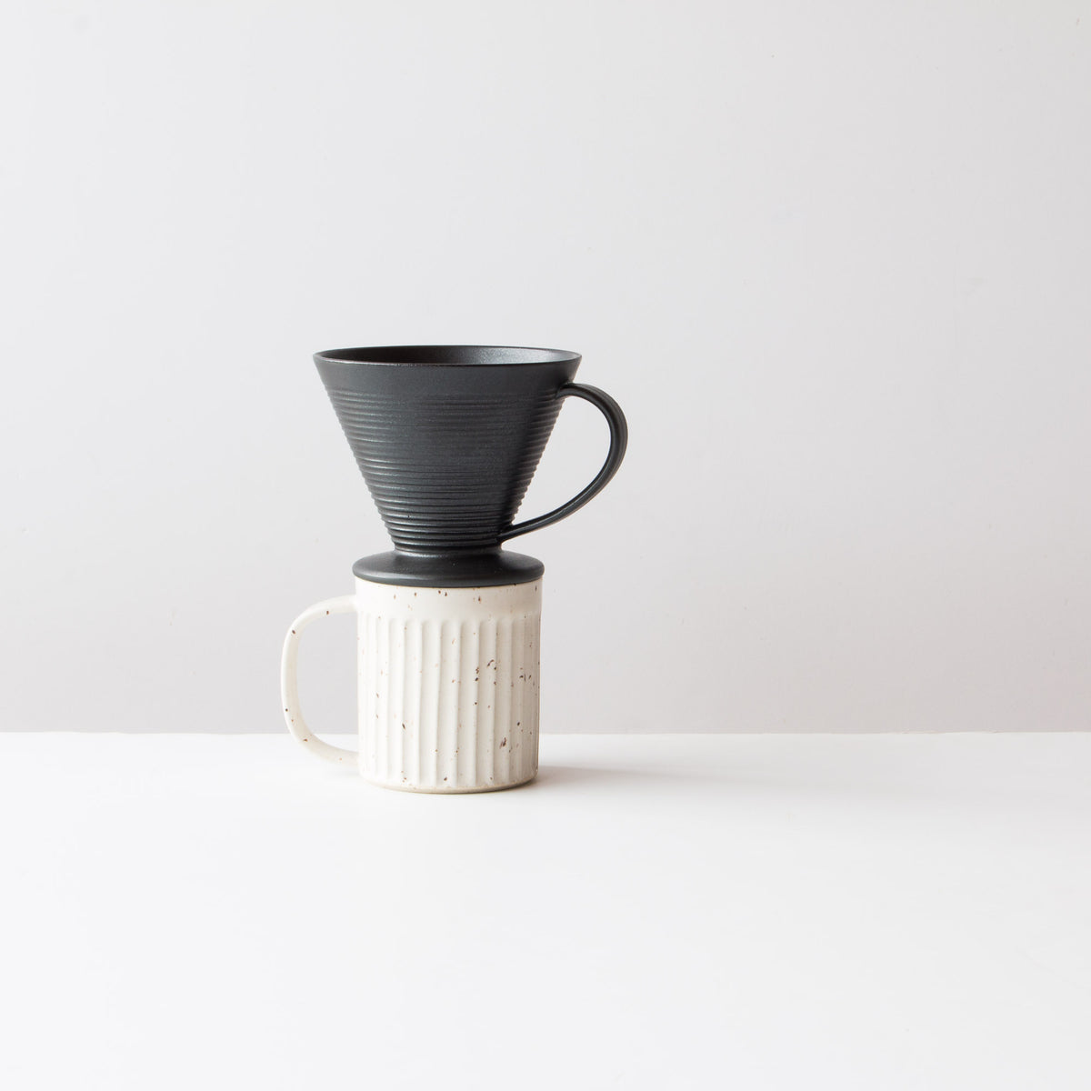 Black - Handmade Ceramic Pour-Over Coffee Dripper Shown with Coffee Mug - Sold by Chic & Basta