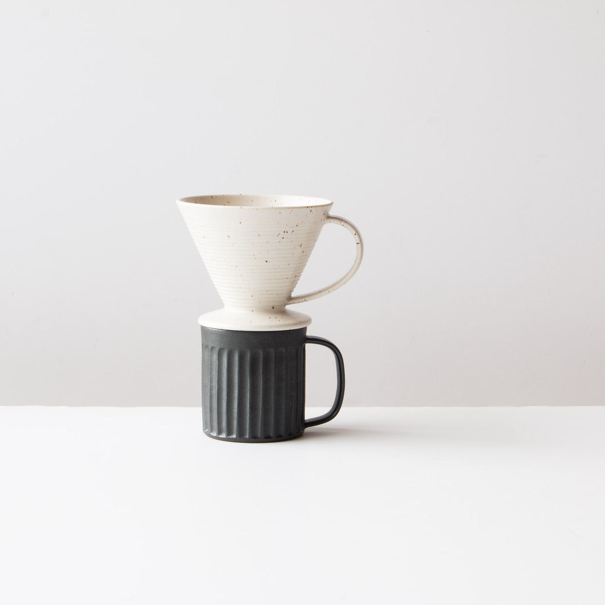 Speckled Off-White - Handmade Ceramic Pour-Over Coffee Dripper Shown with Coffee Mug - Sold by Chic & Basta