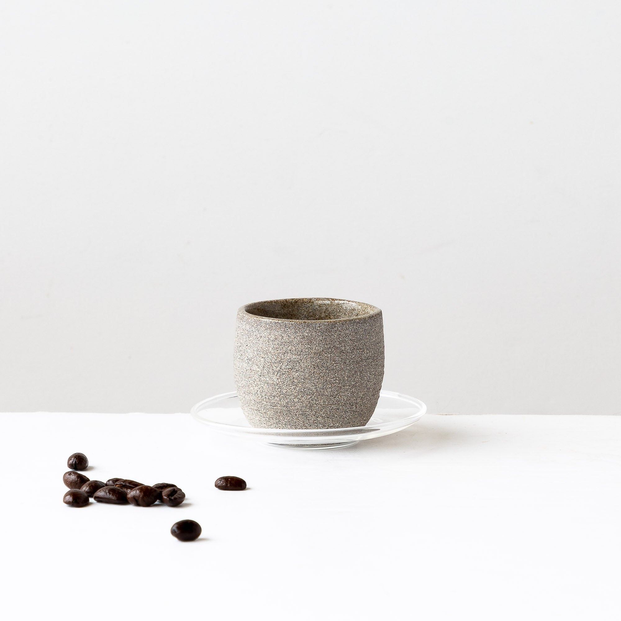 Handmade Stoneware Espresso Coffee Cup & Glass Saucer - Shown with Coffee Beans - Sold by Chic & Basta
