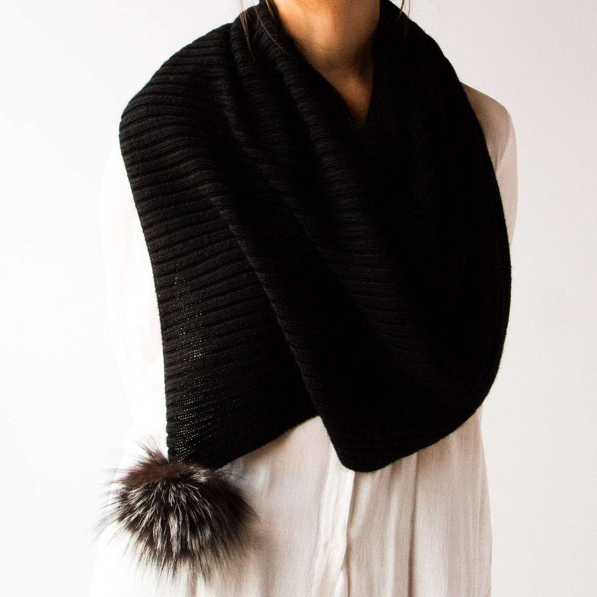 Front View of a Woman Wearing a Black Handmade 100% Baby Alpaca Wool Shawl / Poncho Style - Sold by Chic & Basta