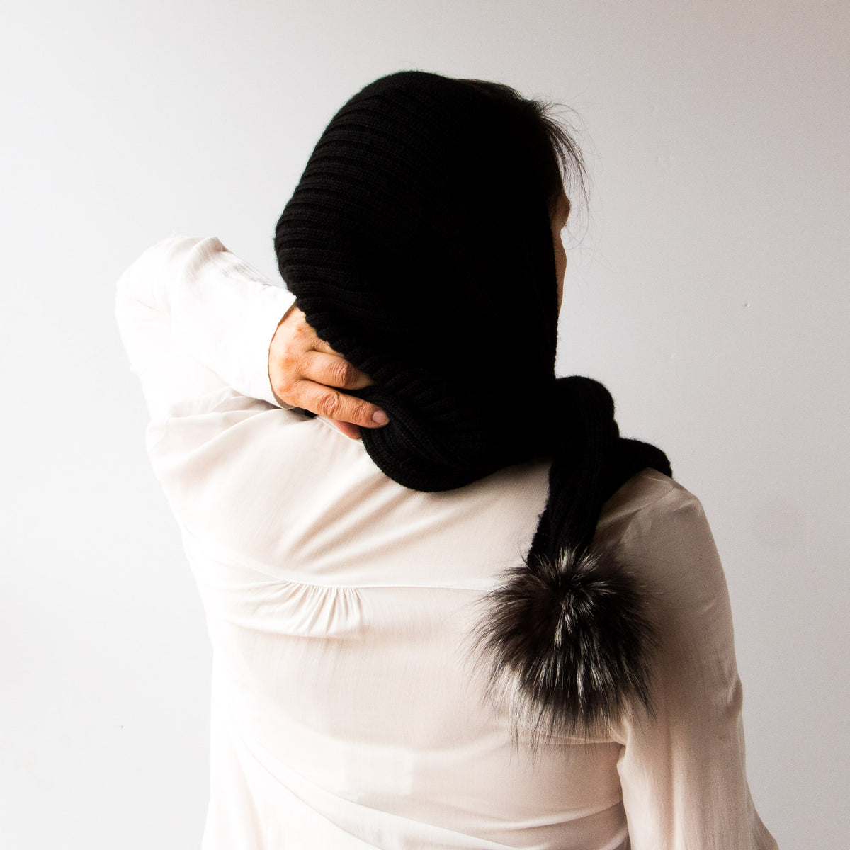 Back of a Woman Wearing a Black Handmade 100% Baby Alpaca Wool Shawl / Poncho Style - Sold by Chic & Basta