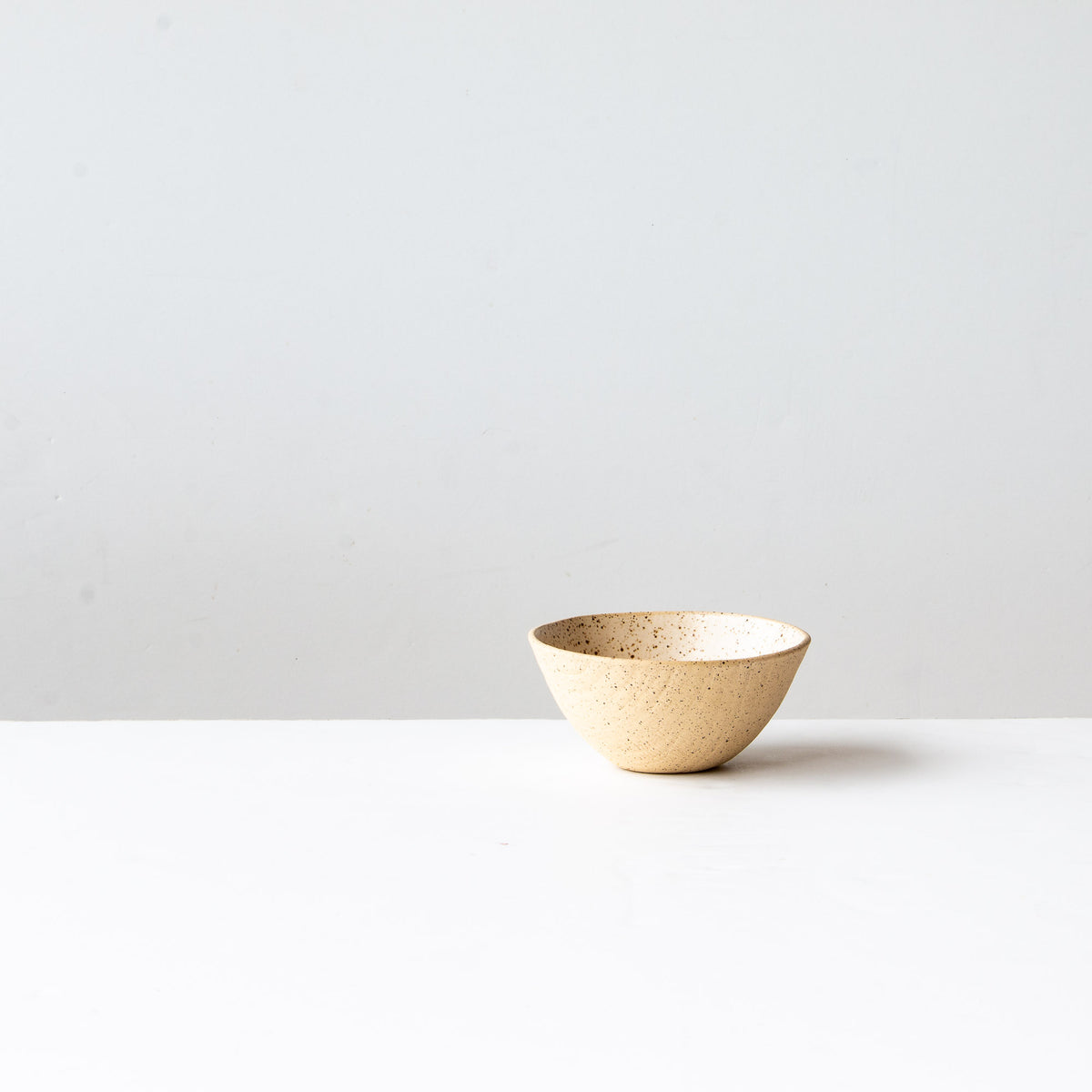 Side View - Off-White Handmade Freckled Ice Cream Bowl in Sandstone Ceramic - Sold by Chic & Basta