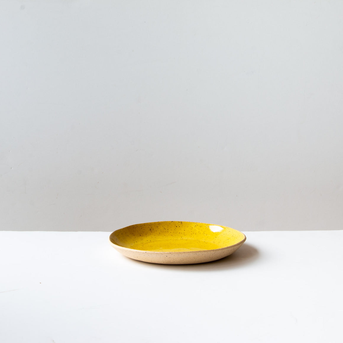 Off-white Handmade Freckled Salad Plate in Stoneware - Sold by Chic & Basta