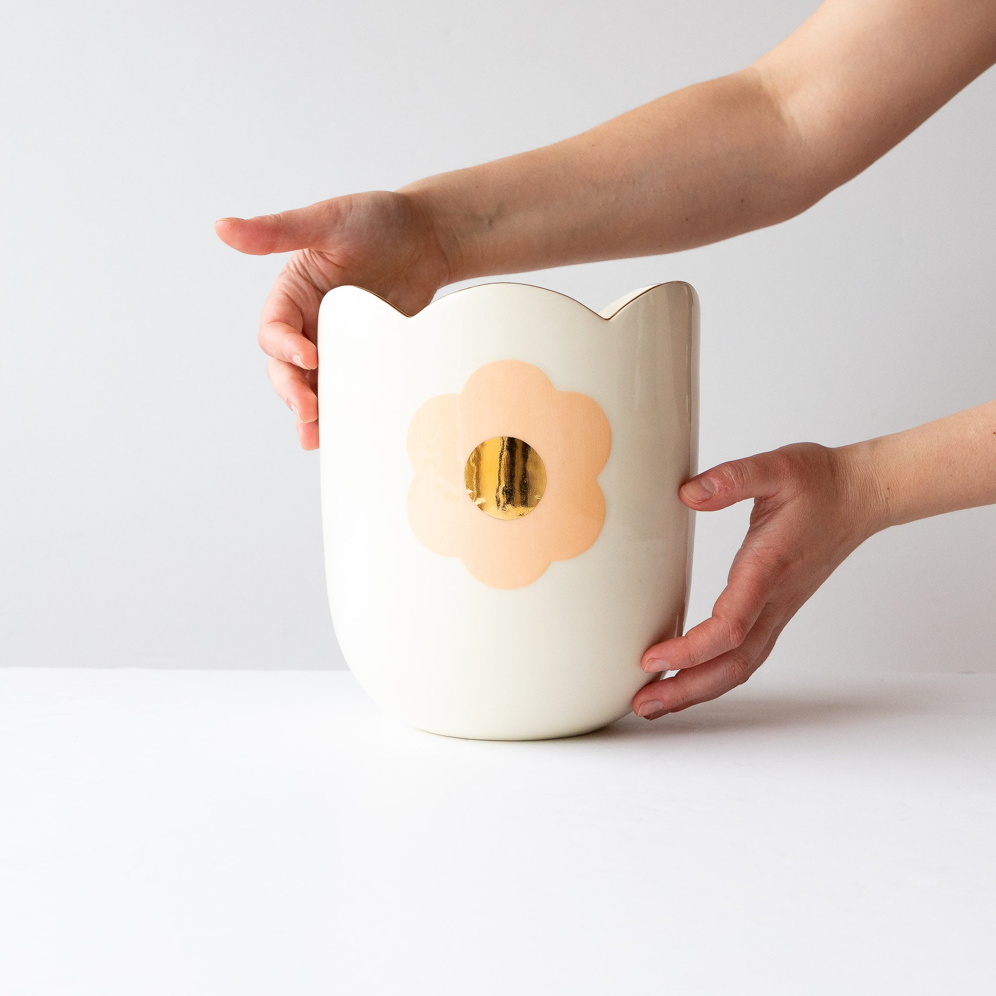 Model Holding a Handmade Porcelain & Gold Tangerine Daisy Planter / Vase - Sold by Chic & Basta