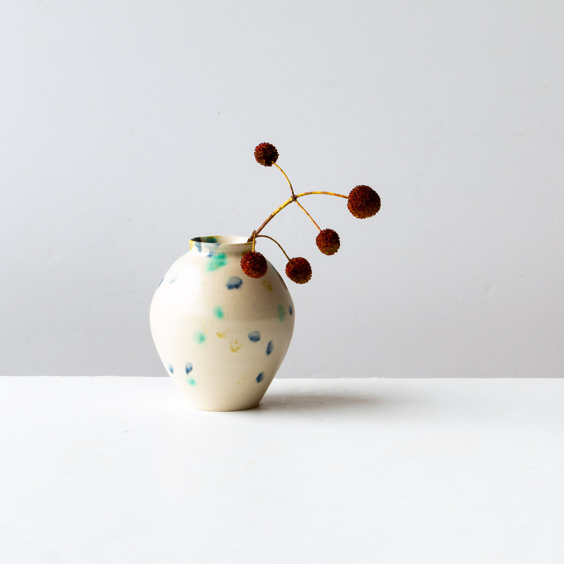 Hanabira - Handmade Small Ceramic Vase Shown on Black Background - Sold by Chic & Basta