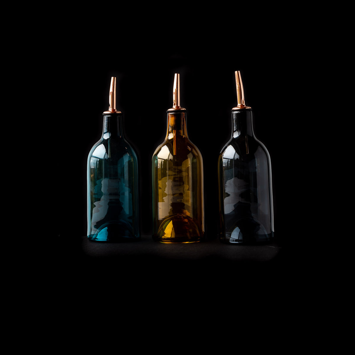 Three Hand-blown Glass Oil / Vinegar Bottles on Black Background - Sold by Chic & Basta