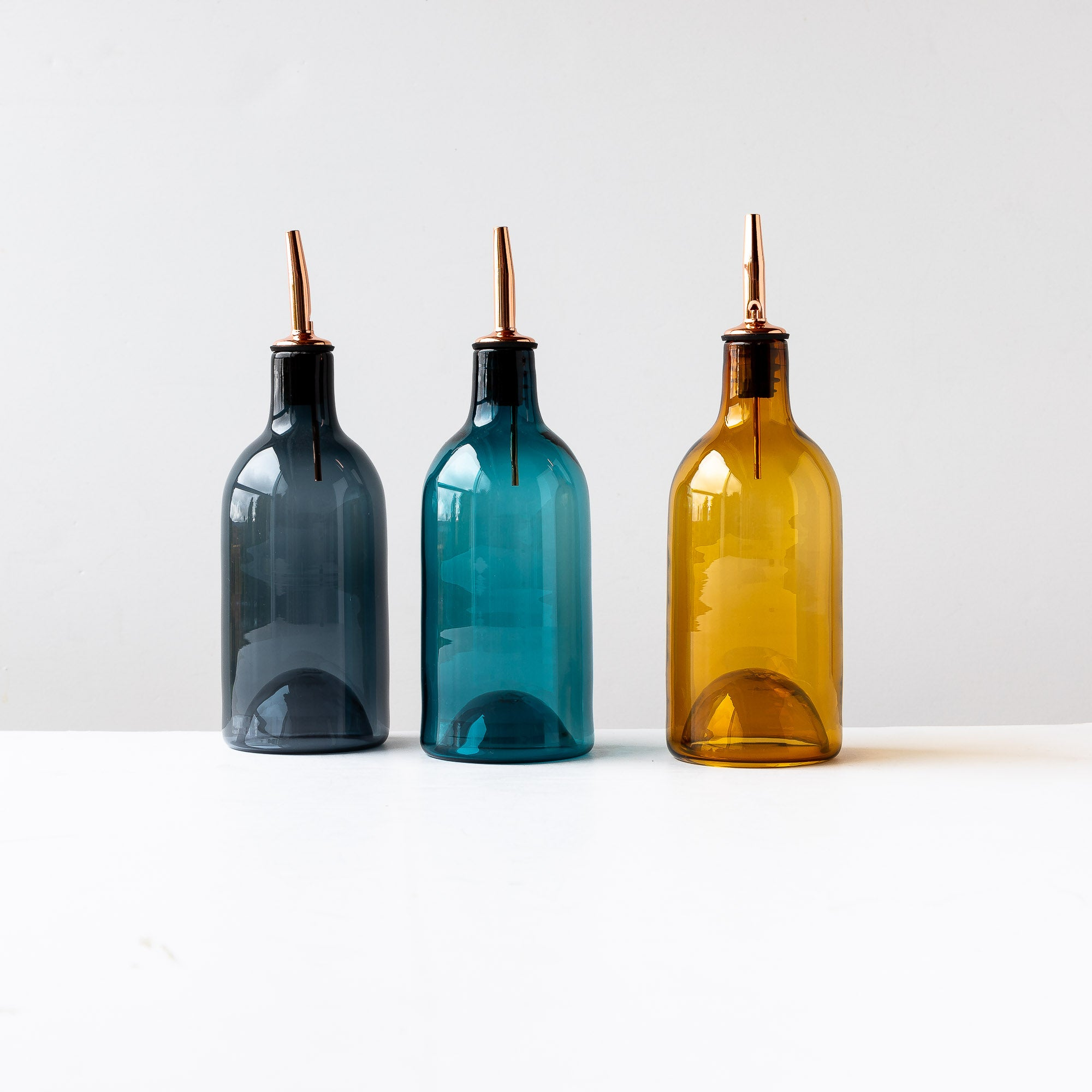 Three Hand-blown Glass Oil / Vinegar Bottles- Sold by Chic & Basta