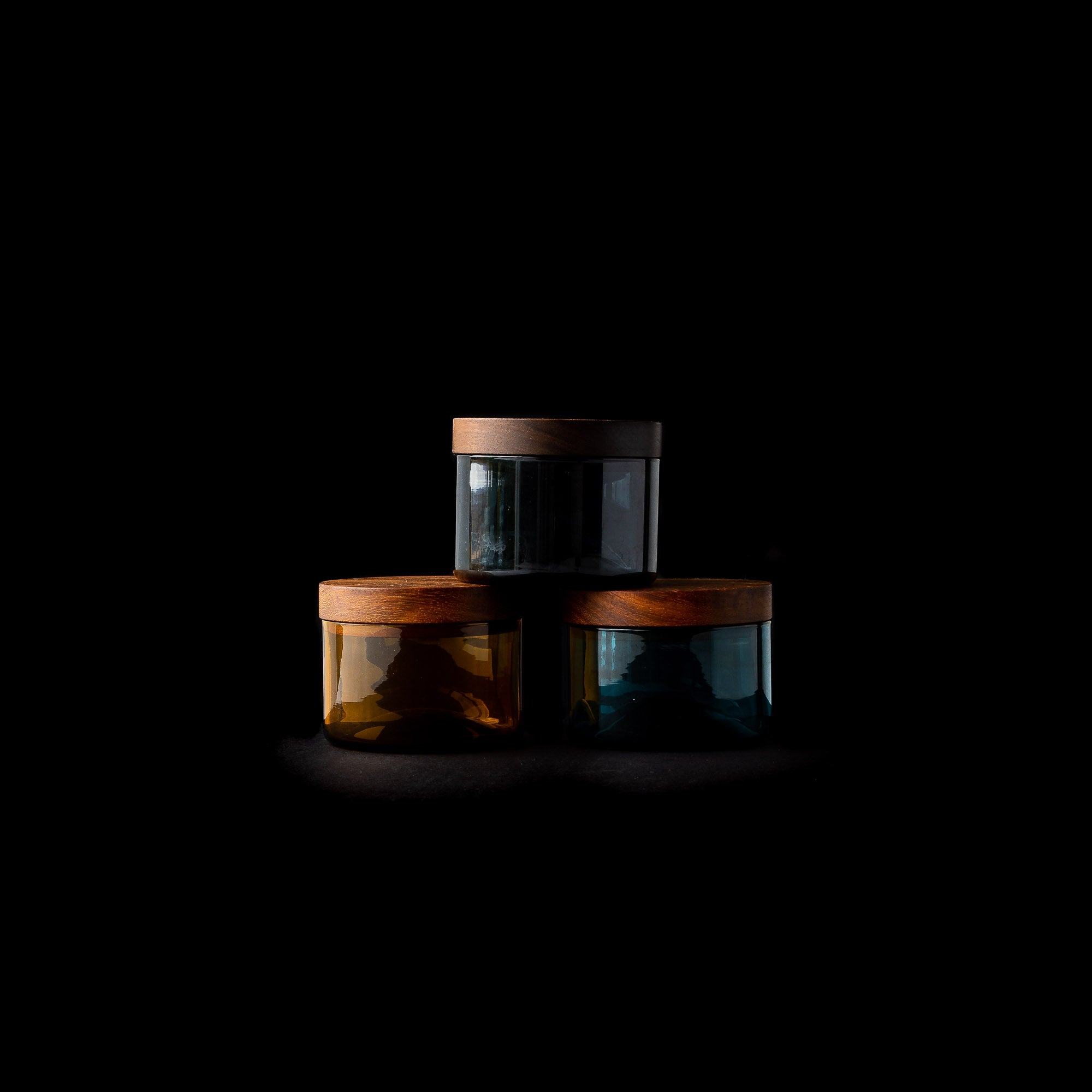 Three Hand-blown Salt Cellars With Black Walnut Cover Shown on Black Background - Sold by Chic & Basta