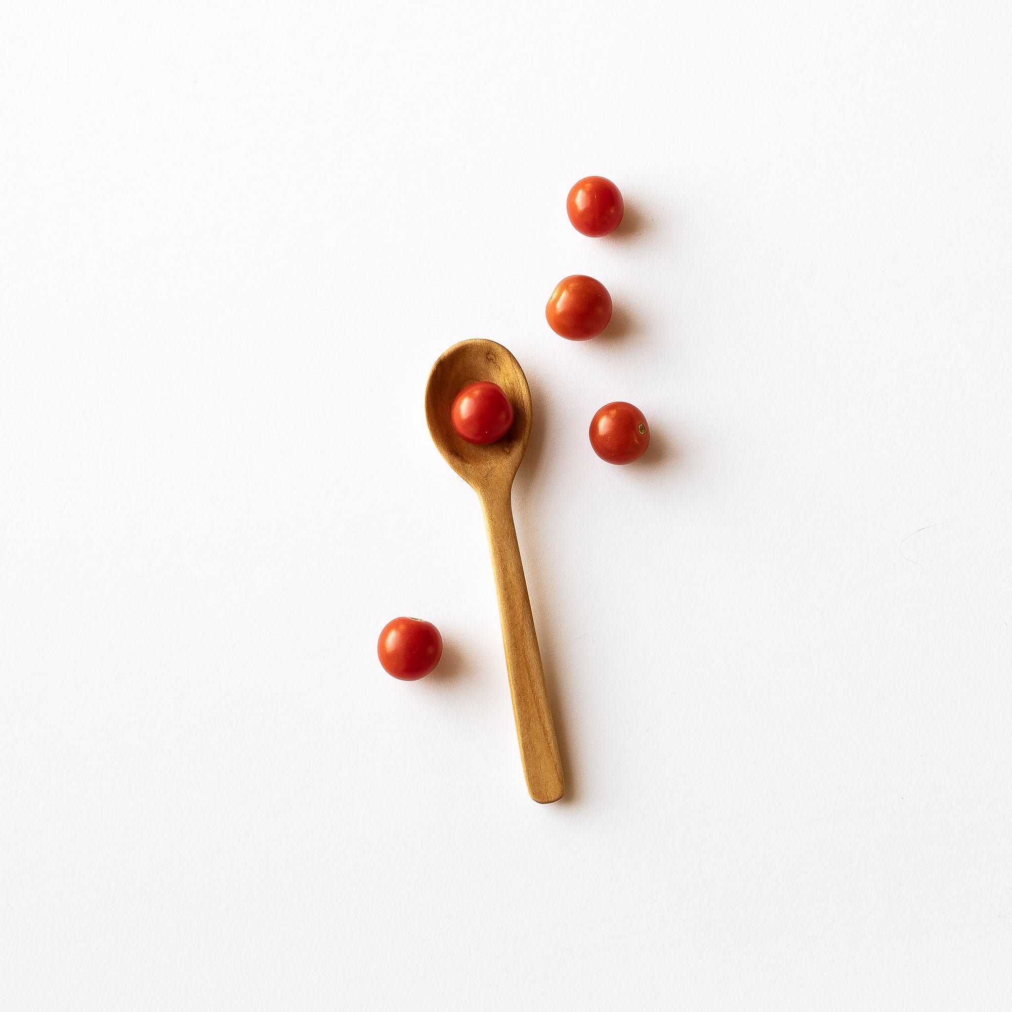 Hand-carved Basswood Little Spoon Shown with Cherry Tomatoes - Sold by Chic & Basta