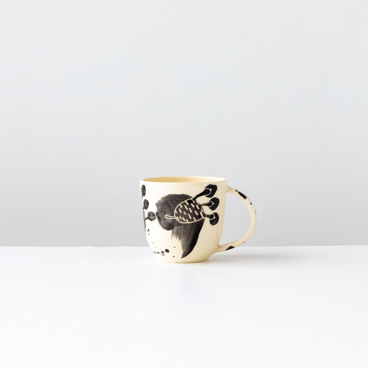 One Small Hand Painted Earthenware Mug - Sold by Chic & Basta
