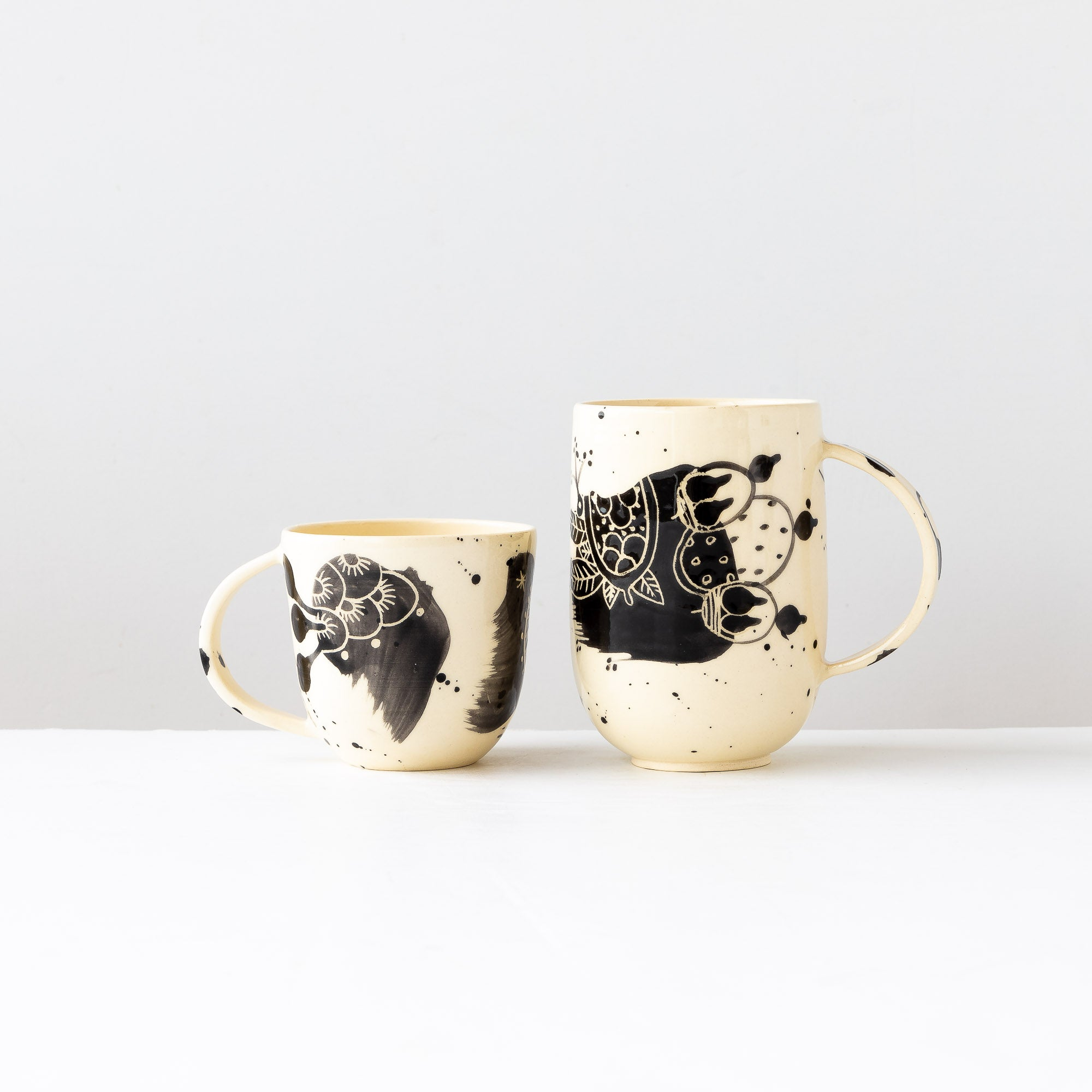 One Large & One Small Hand Painted Earthenware Mugs - Sold by Chic & Basta