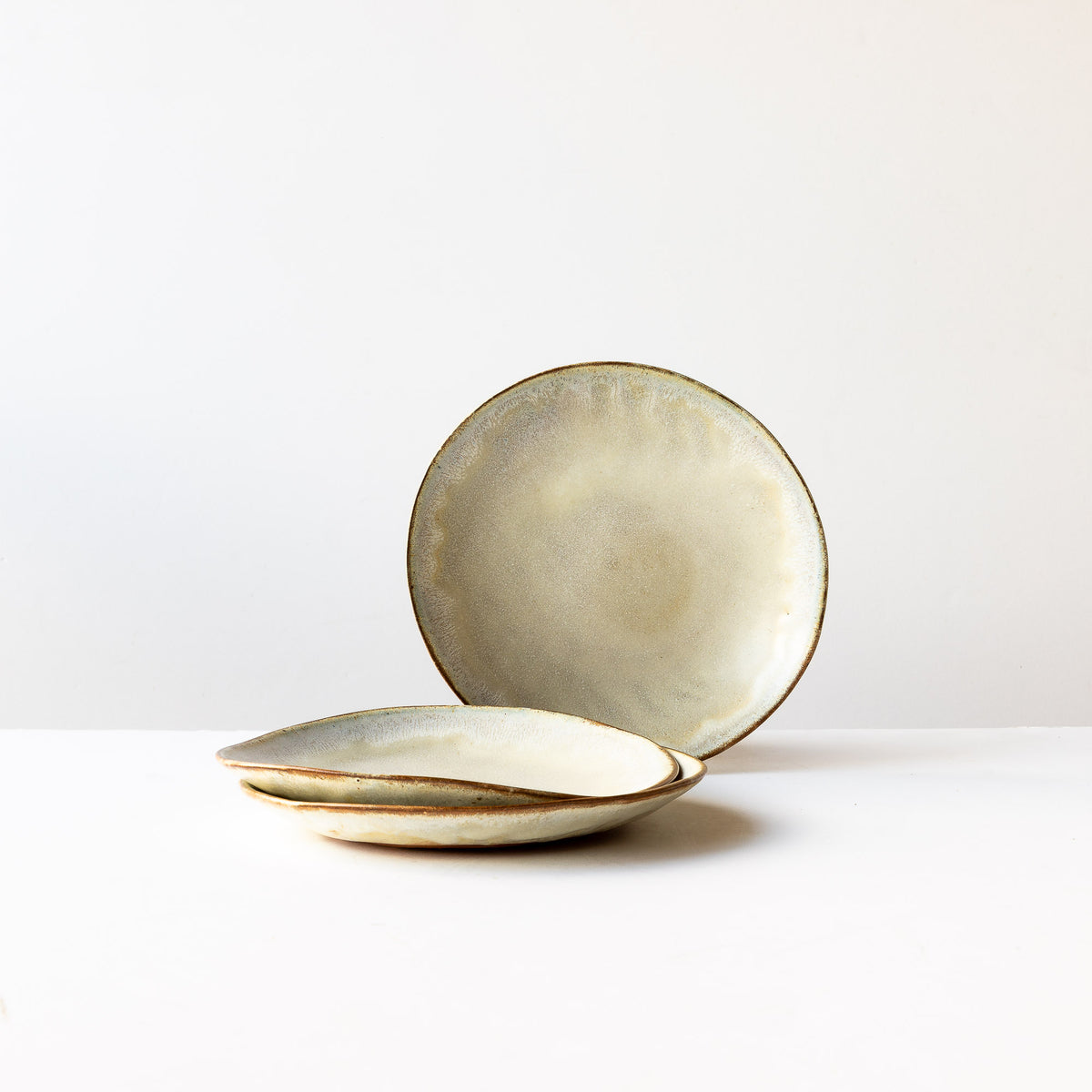 Three Medium Handbuilt Plates in Red Stoneware & Cream Glaze - Sold by Chic & Basta
