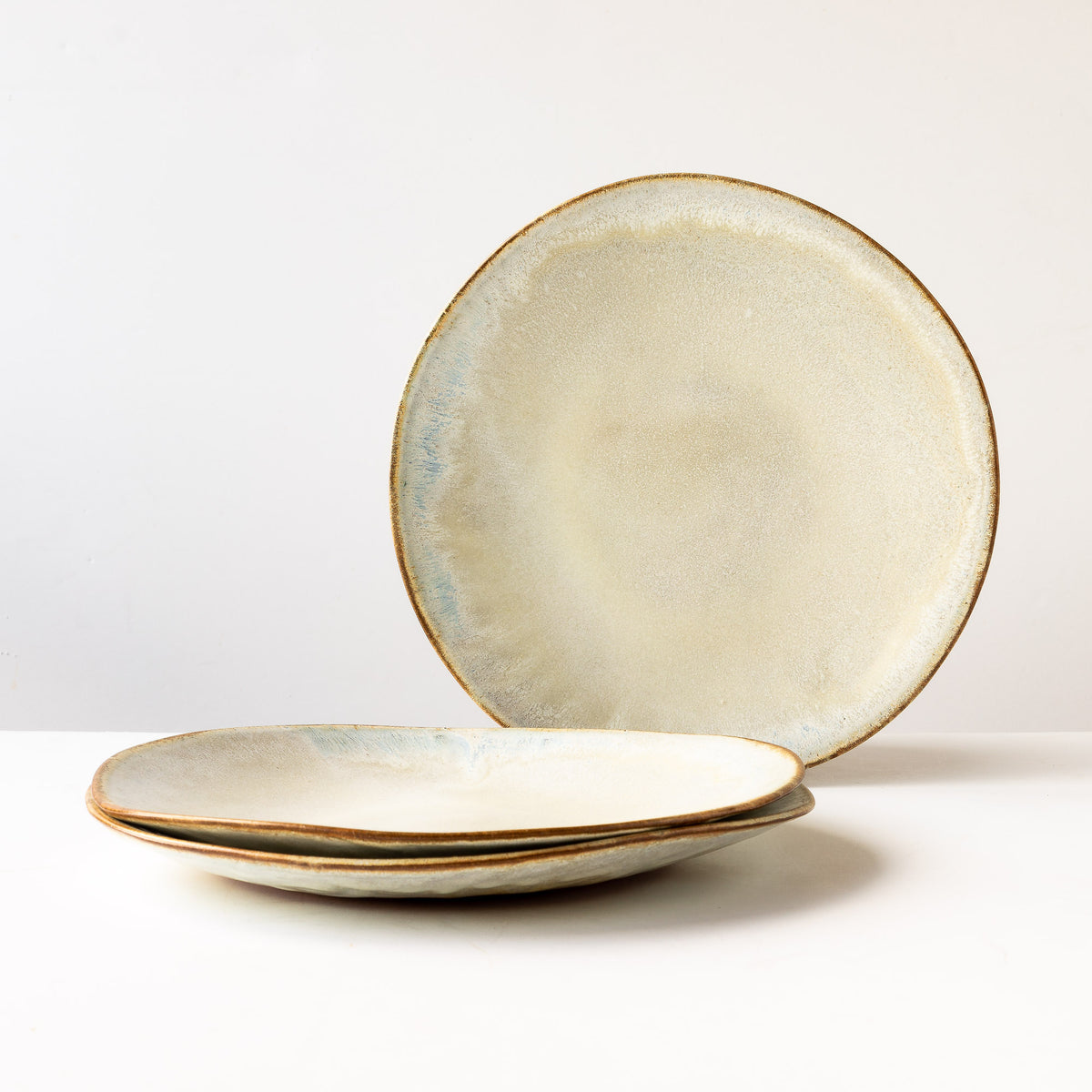 Three Large Handbuilt Plate in Red Stoneware & Cream Glaze - Sold by Chic & Basta