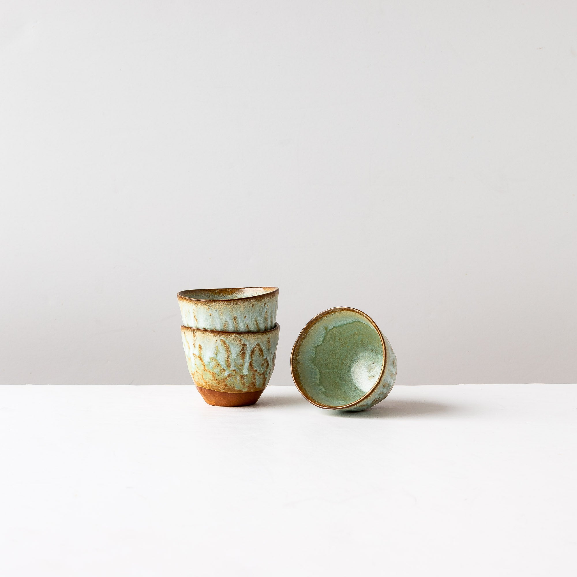 Handbuilt Tea Bowls in Red Stoneware & Turquoise Glaze - Sold by Chic & Basta