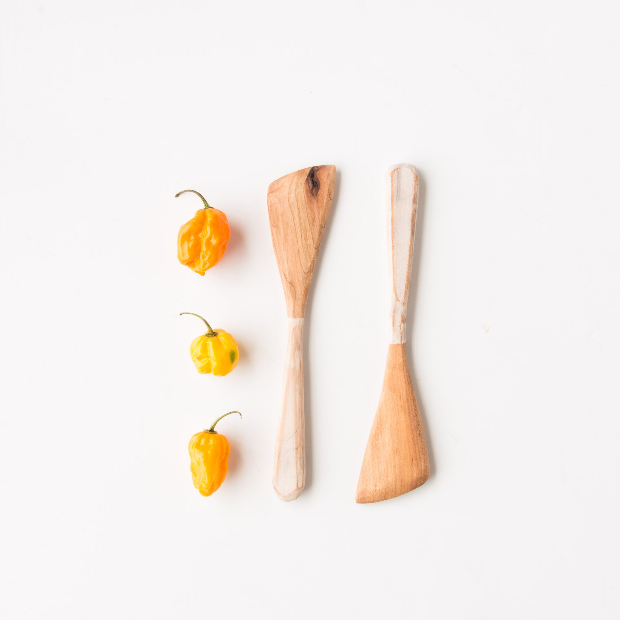 Handcrafted Set of Salad Spatulas in Reclaimed Maple - Photographed With Three Yellow Peppers - Sold by Chic & Basta