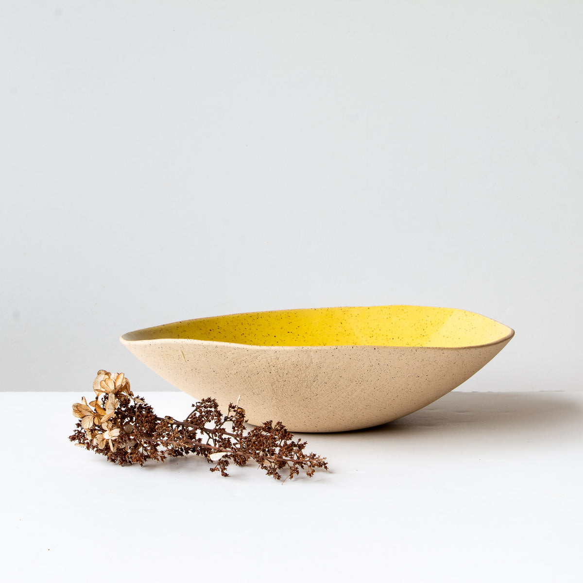 Side View - Handcrafted Large Freckled Stoneware Fruit Bowl - Sold by Chic & Basta